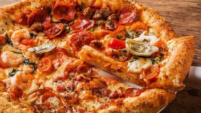 Вся пицца отслужбы доставки «Два берега» соскидкой50%