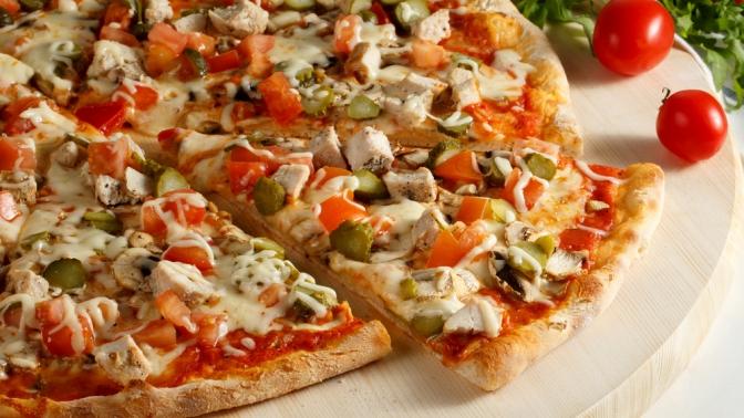 Пицца диаметром 32или 40см сподарком откомпании Pizza Rolly