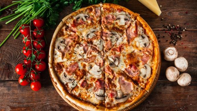 Всё меню без ограничения суммы чека иподарок отслужбы доставки «Конго пицца» соскидкой50%