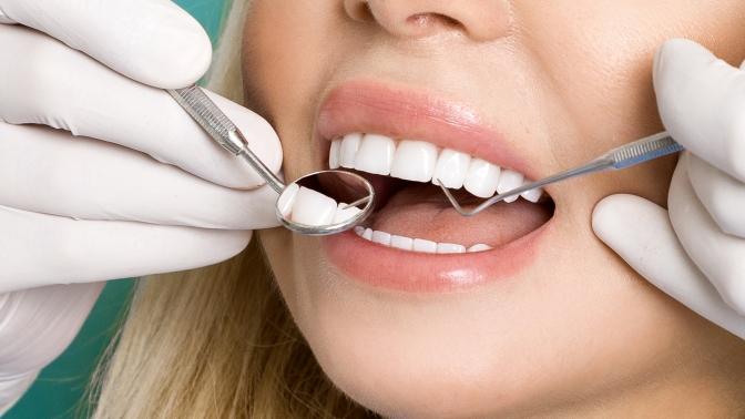 Лечение кариеса 1или 2зубов сустановкой пломбы встоматологии «Олимп»