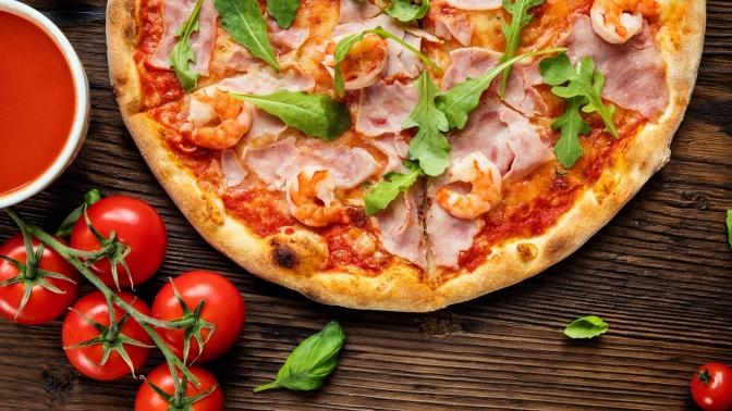 Заказ пиццы без ограничения суммы чека отслужбы доставки «Цунами» соскидкой50%